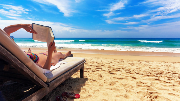 woman-reading-book-at-beach-294902